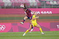 KASHIMA, JAPAN - AUGUST 5: Kelley O'Hara #5 of the United States goes up for a header during a game between Australia and USWNT at Kashima Soccer Stadium on August 5, 2021 in Kashima, Japan.