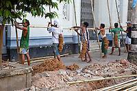 Myanmar, Burma, Yangon.  Men Erecting Bamboo Scaffolding.
