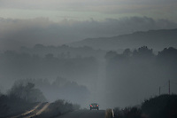A car passes on a road filled with smoke a day after a wildfire in Cualedro, near Ourense on August 31, 2015. A fire broke out on August 30, 2015 around noon in the Cualedro town in Galicia, northwest Spain, affecting at least 3,180 hectares of forest, as seven fires continued to burn in Spain, three in Galicia, one in Cantabria, one in Castile and Leon, one in Catalonia and Extremadura. © Pedro ARMESTRE