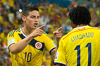 James Rodriguez of Columbia celebrates scoring a goal with Juan Cuadrado after making it 2-0