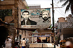 14 April 2013, Karachi, Pakistan: Street posters of local strong man Uzair Baloch (at right) near his home in the slum suburb of Lyari, Karachi.<br /> Lyari is a place out of control and the gangsters running the slum have more support from residents for getting things done than the elected politicians.Karachi is a city wracked by violence and many fault lines that span Taliban infiltration, mafia rackets, sectarian violence and corruption from politicians and security forces. Picture by Graham Crouch/The Australian
