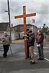 Good Friday Walk of Witness Crowland Lincolnshire 2018. Interdenominational  service from Crowland Abbey and ending at Trinity Bridge.  Sponsored by Christians Together in Crowland.  Led by Revd. Charles Brown, Priest-in-charge and Mick Goodman from the  Methodist Chapel, along with  Father Jim Burke from the Roman Catholic community in Spalding.<br /> <br /> Member of the congregation reading the prayer from his mobile devise.