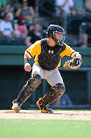 Catcher Reese McGuire (24) of the West Virginia Power in a game against the Greenville Drive on Sunday, May 11, 2014, at Fluor Field at the West End in Greenville, South Carolina. McGuire is the No. 8 prospect of the Pittsburgh Pirates, according to Baseball America. Greenville won, 9-6. (Tom Priddy/Four Seam Images)