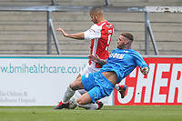 Jez Lynch (F2 Freestylers) is tackled by Warren Phillips during the Celebrity football match in aid of the charity's 'Keep Moving Forward' programme which benefits people with mental health issues put together by Wycombe Wanderers Sports & Education Trust and Sellebrity Soccer Football Match at Adams Park, High Wycombe, England on 7 April 2019. Photo by David Horn.