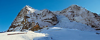 Jungfraujoch train at Kleiner Scheidegg in winter  with The Eiger (left) then The Monch Mountains. Swiss Alps Switzerland