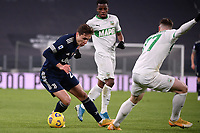 Federico Chiesa of Juventus FC and Georgios Kyriakopoulos of US Sassuolo compete for the ball during the Serie A football match between Juventus FC and US Sassuolo Calcio at Allianz stadium in Torino (Italy), January 10th, 2021. Photo Federico Tardito / Insidefoto