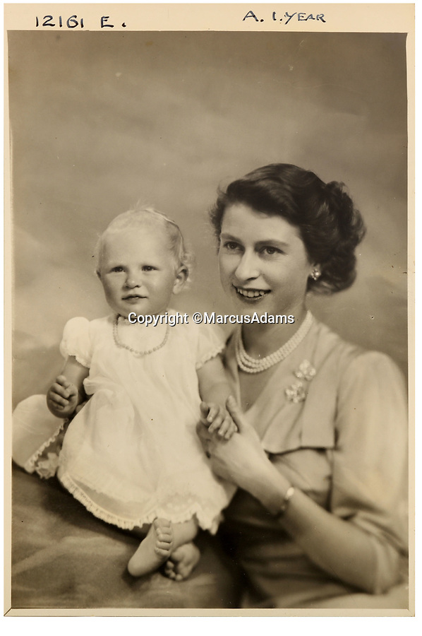 BNPS.co.uk (01202 558833)<br /> Pic: MarcusAdams/ChiswickAuctions/BNPS<br /> <br /> The Queen with Princess Anne aged 1.<br /> <br /> Charming childhood photos of Princess Elizabeth and Princess Margaret have come to light, including a previously unseen image of the future Queen in a kilt.<br /> <br /> The portraits, taken by acclaimed British society photographer Marcus Adams, capture the future Queen from being a baby to her adolescence.<br /> <br /> The Queen Mother would often take her daughters to his central London studio where he would set up toys and props to keep them entertained