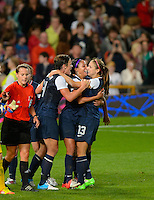 Manchester, England - Monday, August 6, 2012: The USA defeated Canada 4-3 in overtime in the semi-final round of the 2012 London Olympics at Old Trafford. Aex Morgan (13)  celebrates with Abby Wambach (14) and Sydey Leroux after scoring the winning goal.