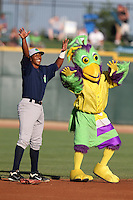 Mascot BirdZerk! and Beloit Snappers second baseman Reggie Williams #18 dance for the fans during a game against the Great Lakes Loons at Dow Stadium on July 22, 2011 in Midland, Michigan.  Great Lakes defeated Beloit 5-2.  (Mike Janes/Four Seam Images)