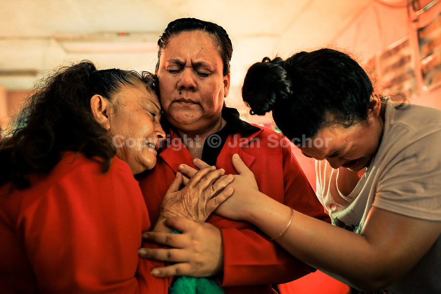 Christian followers, members of a local religious cult, cry desperately during the religious exaltation in a home church in San Salvador, El Salvador, 25 November 2018. A small community of believers gathers every week in an unmarked home church to carry out prayers of liberation, invocations and the so-called evil expulsion rites. Reciting religious formulas through very loud speakers, using manipulative verbal techniques, intimidation and intense charisma, the leading pastor commands the supposed evil spirits to depart a devotee's mind and body which should bring to a devotee a spiritual relief.