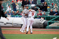 Rochester Red Wings Luis Arraez (9) celebrates a walk off single with Tomas Telis during an International League game against the Charlotte Knights on June 16, 2019 at Frontier Field in Rochester, New York.  Rochester defeated Charlotte 3-2 in the second game of a doubleheader.  (Mike Janes/Four Seam Images)