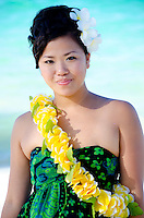 Portrait of Japansese Bikaryoo wearing a yellow lei at the beach in Hawaii
