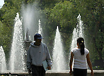 MAN ADMIRES YOUNG WOMAN AT FOUNTAIN IN MEXICO CITY