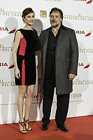 MADRID, SPAIN - MARCH 26: (L-R) Actress Olga Kurylenko and actor Russell Crowe attend the 'El Maestro del Agua' premiere at the Callao cinema on March 26, 2015 in Madrid, Spain.<br /> <br /> People:  Olga Kurylenko, Russell Crowe