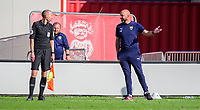Oxford United's goalkeeping coach Wayne Brown speaks to the assistant referee after Oxford United's Rob Atkinson was shown a red card by referee Andy Davies<br /> <br /> Photographer Chris Vaughan/CameraSport<br /> <br /> The EFL Sky Bet League One - Saturday 12th September 2020 - Lincoln City v Oxford United - LNER Stadium - Lincoln<br /> <br /> World Copyright © 2020 CameraSport. All rights reserved. 43 Linden Ave. Countesthorpe. Leicester. England. LE8 5PG - Tel: +44 (0) 116 277 4147 - admin@camerasport.com - www.camerasport.com - Lincoln City v Oxford United