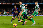Jose Andres Guardado Hernandez of Real Betis (C) fights for the ball with Luis Alberto Suarez Diaz of FC Barcelona (L) during the La Liga 2018-19 match between FC Barcelona and Real Betis at Camp Nou, on November 11 2018 in Barcelona, Spain. Photo by Vicens Gimenez / Power Sport Images