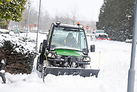 Maintenance worker Pedro Hernandezplows snow, Monday, February 15, 2021 in front of Dillards at Pinnacle Hills Promenade in Rogers. Check out nwaonline.com/210216Daily/ for today's photo gallery. <br /> (NWA Democrat-Gazette/Charlie Kaijo)