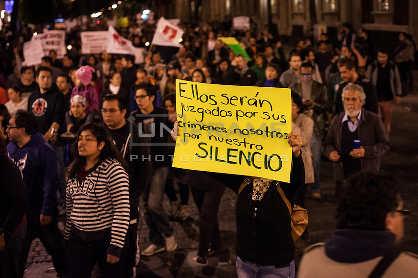 Protest in México City. People demands from the government to explain what happened to the 43 students that went missing on September 26, 2014  from Raúl Isidro Burgos Rural teachers college of Ayotzinapa in Iguala Guerrero. On November 7th the government found ashes in a dumpster near Iguala. They presume could belong to the missing students. México City, México. Nov. 8, 2014.