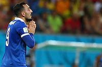 Konstantinos Mitroglou of Greece shows a look of dejection