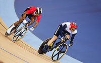 06 AUG 2012 - LONDON, GBR - Jason Kenny (GBR) of Great Britain (right) leads Njisane Nicholas Phillip (TRI) (left) of Trinidad and Tobago during their Individual Sprint semi final first race at the London 2012 Olympic Games track cycling at the Olympic Park Velodrome in Stratford, London, Great Britain (PHOTO (C) 2012 NIGEL FARROW)