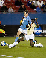 Wake Forest defender Ike Opara (23) slide tackles North Carolina midfielder Zach Loyd (2).  North Carolina Tar Heels defeated Wake Forest Demon Deacons 1-0 in the semifinal match of the NCAA Men's College Cup at Pizza Hut Park in Frisco, TX on December 12, 2008.  Photo by Wendy Larsen/isiphotos.com
