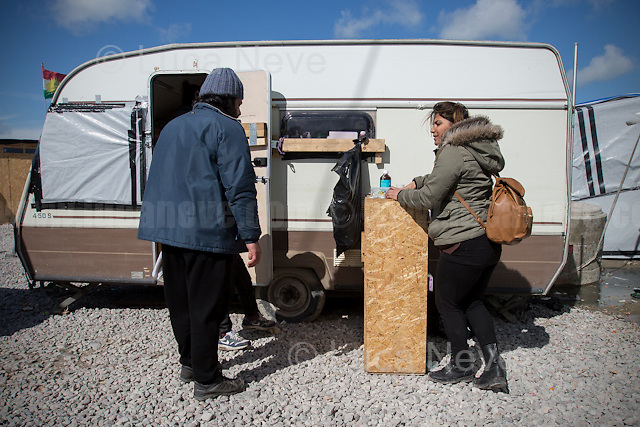 """Najem.<br /> <br /> First Aid Camp - Second Team.<br /> <br /> Calais Jungle Camp.<br /> <br /> Under the Sky of Calais & Dunkirk. Two Camps, Two Sides of the Same Coin: Not 'migrants', Not 'refugees', just Humans.<br /> <br /> France, 24-30/03/2016. Documenting (and following) Zekra and her experience in the two French camps at the gate of the United Kingdom: Calais' """"Jungle"""" and Dunkirk's """"Grande-Synthe"""". Zekra lives in London but she is originally from Basra in Iraq. Zekra and her family had to flee Kuwait - where they moved for working reason - due to the """"Gulf War"""", and to the Western Countries' will to """"export Democracy in Iraq"""". Zekra is a self-motivated volunteer and founder of """"Happy Ravers"""", a group of people (not a NGO or a charity) linked to each other because of their love for rave parties but also men and women who meet up every week to help homeless people and other people in need in Central London. (Here there are some of the stories I covered about Zekra and """"Happy Ravers"""": http://bit.ly/1XVj1Cg & http://bit.ly/24kcGQz & http://bit.ly/1TY0dPO). Zekra worked as an English teacher in the adult school at Dunkirk's """"Grande-Synthe"""" camp and as a cultural mediator and Arabic translator for two medic teams in Calais' """"Jungle"""". Please read her story at the beginning of this reportage."""
