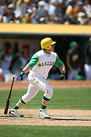 OAKLAND, CA - MAY 4:  Jack Cust of the Oakland Athletics bats and hits a home run during the game against the Texas Rangers at the McAfee Coliseum in Oakland, California on May 4, 2008. This was a turn back the clock day game that featured both teams wearing 1968 era uniforms. The Rangers wore Washington Senators uniforms. Photo by Brad Mangin