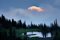 Early morning sunrise with fog. Tipsoo Lake reflection. Mt. Rainier National Par, Washington
