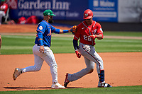 New York Mets shortstop Luis Guillorme (13) tags Juan Soto (22) out after a run down during a Major League Spring Training game against the Washington Nationals on March 18, 2021 at Clover Park in St. Lucie, Florida.  (Mike Janes/Four Seam Images)