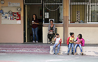 Pictured: Three young migrant girls wait to go to class at the Thissio 72nd Primary School of Athens Greece. Monday 10 October 2016<br /> Re: Children of refugees have started school in various parts of Greece.