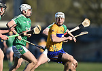 Pat O Connor of  Clare  in action against Sean Finn of  Limerick during their NHL quarter final at the Gaelic Grounds. Photograph by John Kelly.