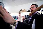 Edmonton - April 8, 2010 - Edmontonian-turned New Yorker designer Michael Kaye helps models prepare back stage during Western Canada Fashion Week. PHOTO BY JIMMY JEONG