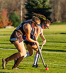 WASHINGTON, CT-111020JS08 —Thomaston's Emma Sanson (16) and Shepaug's Brianna Laskowski (14) try to get possession of the ball during their field hockey game Tuesday at Shapaug High School. <br /> Jim Shannon Republican-American