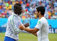 Mario Balotelli of Italy and Luis Suarez of Uruguay shake hands before kick off