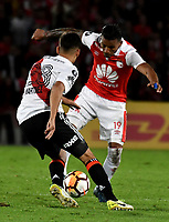 BOGOTÁ - COLOMBIA, 03-05-2018: Wilson Morelo (Der.) jugador de Independiente Santa Fe disputa el balón con Lucas Martínez (Izq.) jugador de River Plate, durante partido entre Independiente Santa Fe (COL) y River Plate (ARG), de la fase de grupos, grupo D, fecha 5 de la Copa Conmebol Libertadores 2018, jugado en el estadio Nemesio Camacho El Campin de la ciudad de Bogota. / Wilson Morelo (R) player of Independiente Santa Fe vies for the ball with Lucas Martinez (L) player of River Plate, during a match between Independiente Santa Fe (COL) and River Plate (ARG), of the group stage, group D, 5th date for the Conmebol Copa Libertadores 2018 at the Nemesio Camacho El Campin Stadium in Bogota city. Photo: VizzorImage  / Luis Ramírez / Staff.