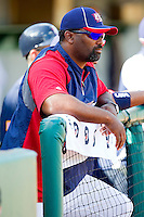 Team USA Manager Ernie Young #39 watches the action from the dugout during an exhibition game against Team Canada at the USA Baseball National Training Center on September 29, 2011 in Cary, North Carolina.  (Brian Westerholt / Four Seam Images)