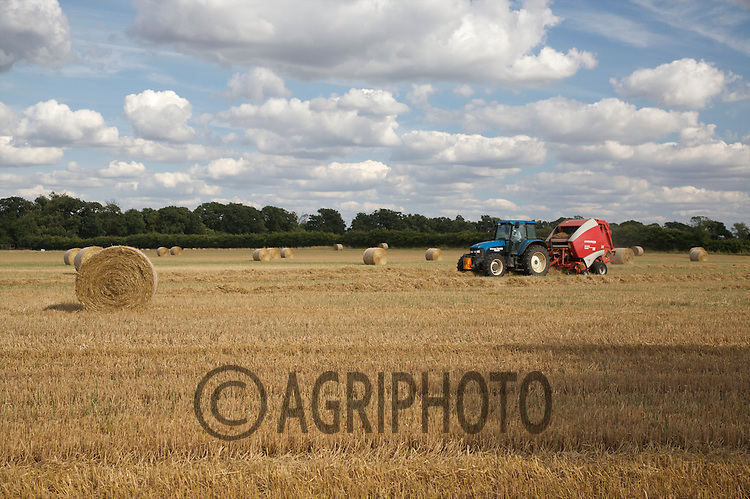 New Holland Tractor Baling Wheat Straw