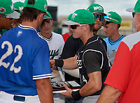 Wharton Wildcats infielder Zach Ehrhard (14) is congratulated by teammates after receiving the Most Valuable Player Award after the 42nd Annual FACA All-Star Baseball Classic on June 6, 2021 at Joker Marchant Stadium in Lakeland, Florida.  (Mike Janes/Four Seam Images)