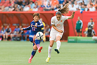 June 23, 2015: Shinobu OHNO of Japan kicks for goal during a round of 16 match between Japan and Netherlands at the FIFA Women's World Cup Canada 2015 at BC Place Stadium on 23 June 2015 in Vancouver, Canada. Japan won 2-1. Sydney Low/AsteriskImages.com