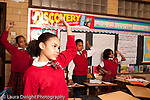 K-8 Parochial School Bronx New York Grade 5 physical activity students taking a stretching break horizontal