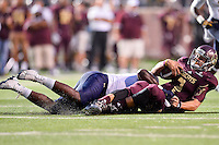 Texas State quarterback Tyler Jones (2) is tackled by Navy defender during NCAA Football game, Saturday, September 13, 2014 in San Marcos, Tex. Navy defeated Texas State 35-21.(Mo Khursheed/TFV Media via AP Images)