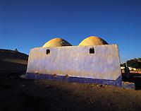 Evening light ona traditional blue-washed Nubian house near Aswan, Egyp