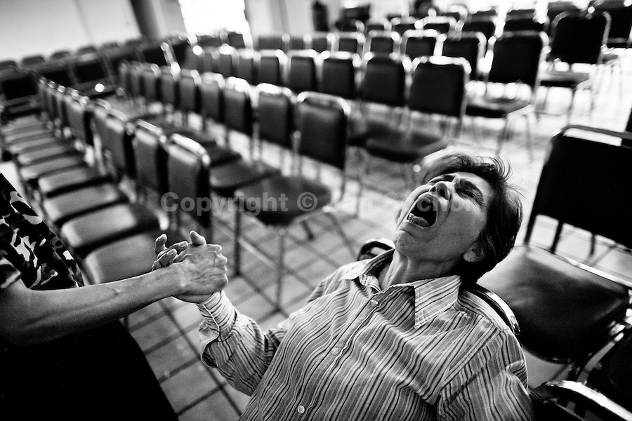A Mexican woman screams intensively during the exorcism rite performed at the Church of the Divine Saviour in of Mexico City, Mexico, 31 May 2011. Exorcism is an ancient religious technique of evicting spirits, generally called demons or evil, from a person which is believed to be possessed. Although the formal catholic rite of exorcism is rarely seen and must be only conducted by a designated priest, there are many Christian pastors and preachers (known as 'exorcistas') performing exorcism and prayers of liberation. Using their strong charisma, special skills and religous formulas, they command the evil spirit to depart a victim's mind and body, usually invoking Jesus Christ or God to intervene in favour of a possessed person.