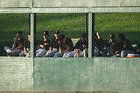 The Delmarva Shorebirds bullpen watches the action from behind the right field wall during the game against the Kannapolis Intimidators at Kannapolis Intimidators Stadium on June 30, 2017 in Kannapolis, North Carolina.  The Shorebirds defeated the Intimidators 6-4.  (Brian Westerholt/Four Seam Images)