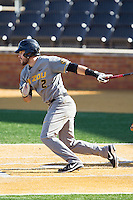 Dillon Everett (2) of the Missouri Tigers follows through on his swing against the Radford Highlanders at Wake Forest Baseball Park on February 21, 2014 in Winston-Salem, North Carolina.  The Tigers defeated the Highlanders 15-3.  (Brian Westerholt/Four Seam Images)