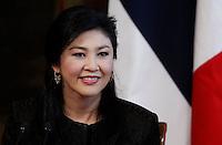 Il Primo Ministro thailandese Yingluck Shinawatra durante una  una conferenza stampa congiunta col Presidente del Consiglio a Palazzo Chigi, Roma, 11 settembre 2013.<br /> Thai Prime Minister Yingluck Shinawatra attends a joint press conference with the Italian Premier at the end of their meeting at Chigi Palace, Rome, 11 September 2013.<br /> UPDATE IMAGES PRESS/Isabella Bonotto