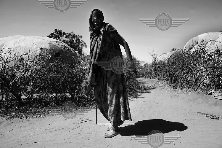 75 year old Saibaaba Hasen Abdi walks blind through Kebribeyah refugee camp. The number of people seeking refuge in Ethiopia has now passed 30,000. The three main camps - Kebribeyah, Awbarre and Sheder - house predominantly Somali refugees..