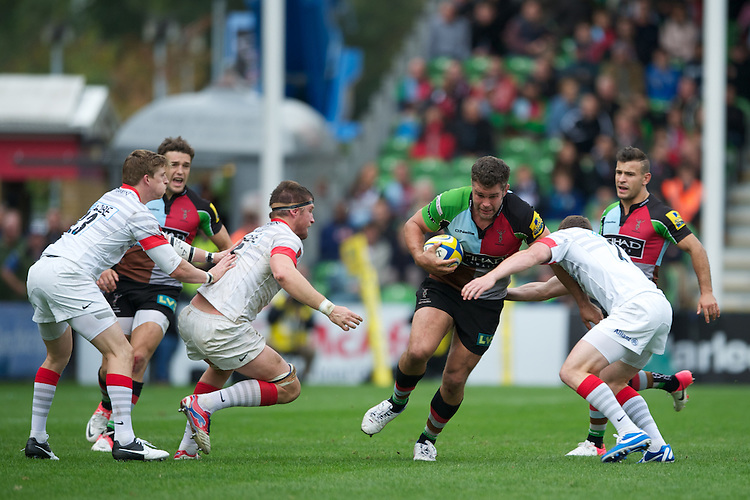 Nick Easter of Harlequins is tackled by Ben Spencer of Saracens during the Aviva Premiership match between Harlequins and Saracens at the Twickenham Stoop on Sunday 30th September 2012 (Photo by Rob Munro)