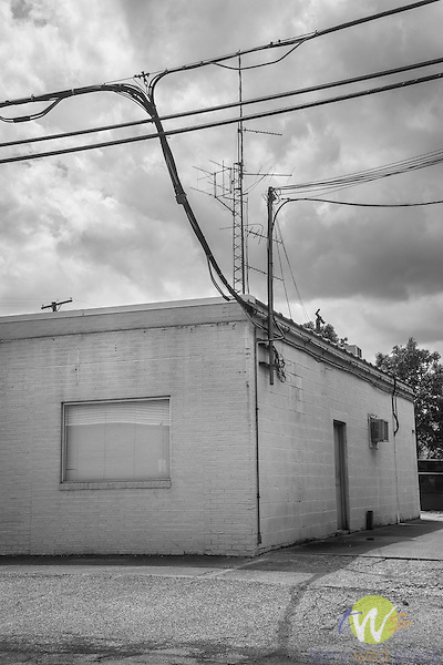 Milton, WV. Cinderblock building and utility wires and antenna.