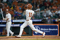 Brenden Dixon (1) of the Texas Longhorns follows through on his swing against the Missouri Tigers in game eight of the 2020 Shriners Hospitals for Children College Classic at Minute Maid Park on March 1, 2020 in Houston, Texas. The Tigers defeated the Longhorns 9-8. (Brian Westerholt/Four Seam Images)